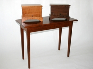 Small chests in cherry (left) and walnut